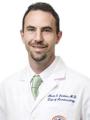 Dr. Mark Larkins, MD