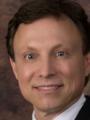 Dr. Olaf Rustad, MD